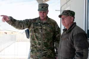 Task Force Titan chief of staff U.S. Army Lt. Col. Frank Kuczynski (left) shows U.S. Air Force Judge Advocate General's School senior instructor Col. Lindsey Graham (right) an overview of the Detention Facility in Parwan Jan. 19, 2013. As part of his Air Force Reserve duties, Graham met with the Joint Legal Center to get an update on changes and progress within the DFIP. Graham also serves as a U.S. senator from South Carolina. U.S. Army photo by Sgt. Katie D. Summerhill