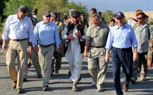 Sens. John McCain, Lindsey Graham and Joe Lieberman and a senatorial advisor discuss future operations and plans with a U.S. special operations forces team leader in Mangwel village, Khas Konar District, Konar province, July 4. The senators visited the village to meet with a village elder and SOF team members to discuss current and future plans for Afghan Local Police and Village Stability Operations. DoD photo by Sgt. Lizette Hart