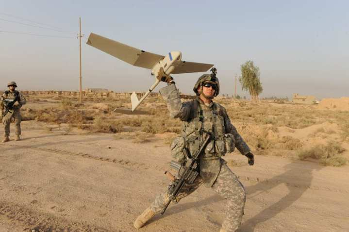 U.S. Army Spc. Cal Treen with 2nd Battalion, 5th Cavalry Regiment (2-5 Cav.), 1st Brigade Combat Team, 1st Cavalry Division, launches a Raven UAV  to provide an aerial view of the area surrounding Joint Security Station UR, in Baghdad, Iraq, in support of the Iraqi Army.  U.S. Army Photo by Spc. Joshua E. Powell