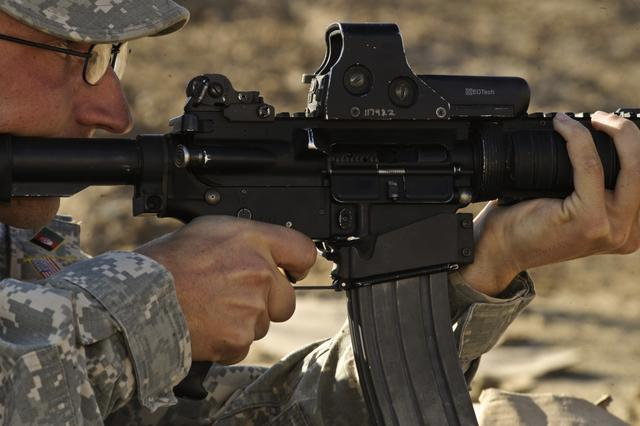 U.S. Army Staff Sgt. David Tucker, with the 3rd Zone Security Forces Advisory Team, test fires his M-4 carbine at Forward Operating Base Walton, Afghanistan, Dec. 21, 2009. U.S. Air Force photo by Tech. Sgt. Efren Lopez.