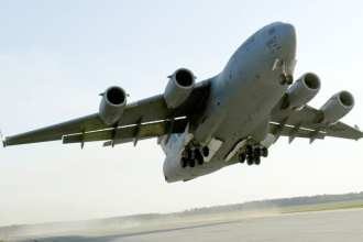 A C-17 Globemaster III takes off April 15, 2010, from Fort Pickett Maneuver Training Center, Va. The aircraft, carrying a group of Navy SEALs, was part of a joint training exercise with members of the 517th Airlift Squadron from Elmendorf Air Force Base, Alaska and SEAL Team 10. The Globemaster III is the workhorse of the Air Force airlift fleet. U. S. Air Force photo by Staff Sgt. Brian Ferguson.