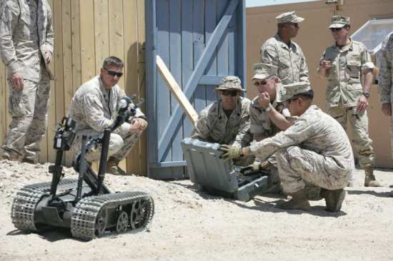 Chairman of the Joint Chiefs of Staff, Adm. Mike Mullen, observes as Explosive Ordnance Disposal technicians operate the remote controlled Talon Robot at the Combat Center's Range 051. U.S. Marine Corps photo by Lance Cpl. Zachary J. Nola.