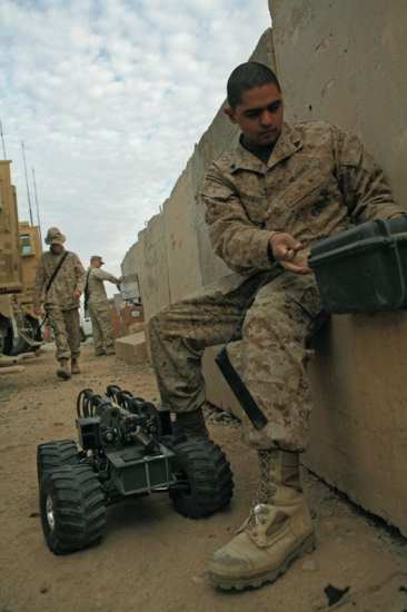 Cpl. Raul Cardenas, 24, from Santa Ana, Calif., vehicle commander for 2nd Squad, Security Company, Combat Logistics Battalion 5, 1st Marine Logistics Group, prepares a Multi-function Agile Remote Control Robot prior to a mission in 2008. The unit was using the MARCbot to safely investigate possible Improvised Explosive Devices and ensure that convoys reached their destination safely. U.S. Marine Corps photo courtesy of 1st MLG.