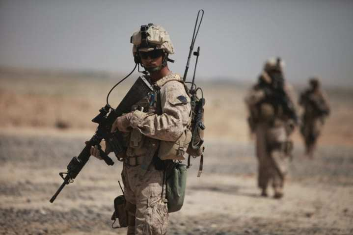 U.S. Marine Corps Lance Cpl. Sean Allen scans the area during a patrol near Fire Base Fiddler's Green, Helmand province, Afghanistan, Aug. 3, 2009. Allen is a radio operator attached to Headquarters Battery, 3rd Battalion, 11th Marine Regiment. The Marines are deployed with Regimental Combat Team 3 to conduct counterinsurgency operations in partnership with the Afghan National Security Forces in southern Afghanistan. The M16 would be familiar to Marines who served all the way back to the Vietnam conflict, but the weapon's sight and array of communications and night vision devices less so. U.S. Marine Corps photo by Sgt. Christopher R. Rye.