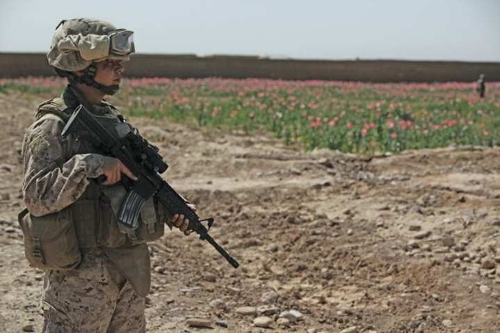 U.S. Marine Cpl. Tara Soulier, member of the 1st Marine Expeditionary Force Forward Female Engagement Team (FET), provides security while on a patrol through local Afghan settlements in Boldak, Afghanistan, April 5, 2010.  The FET engaged in conversation with women of the area in an effort to better gain cultural awareness and ascertain family needs in support of efforts of the International Security Assistance Force assigned to the region. U.S. Marine Corps photo by Cpl. Lindsay L. Sayres.