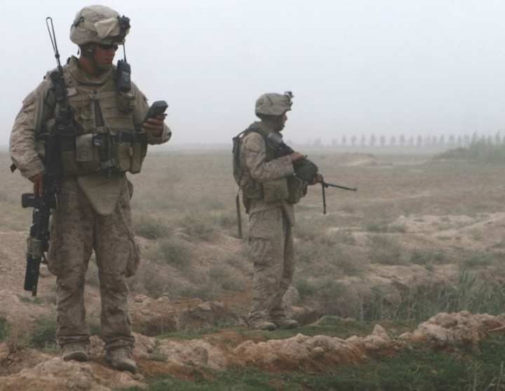 Pfc. Justin Gomez (right), a machine gunner with Kilo Company, 3rd Battalion, 6th Marine Regiment, provides security for a patrol in Marjah, Helmand province, Afghanistan, while Cpl. Mikah Rust, the squad leader, checks his global positioning system, April 15, 2010. Whatever the changes in technology or opponents over the years, according to former Commandant Gen. James Conway, the individual Marine is the most formidable weapon on today's battlefield and will remain so tomorrow. U.S. Marine Corps photo by Lance Cpl. Tommy Bellegarde.
