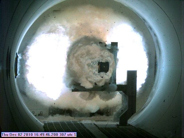 The Office of Naval Research's 33-megajoule world record-breaking railgun shot. The projectile is the dark square at the center of the ignited plasma cloud. Photo courtesy of Office of Naval Research.