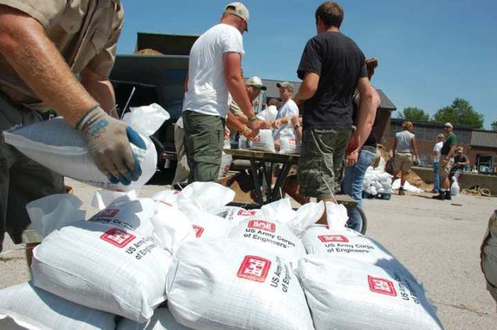 Volunteers from Americorps assist personnel from the Iowa Department of Natural Resources to fill U.S. Army Corps of Engineers-supplied sandbags at the Rathbun Lake Hatchery, July 22, 2010. The area, in southcentral Iowa, was preparing for a spillway discharge. USACE dam safety and flood-fight experts, as well as local, state, and federal agency representatives also responded. FEMA photo by Jace Anderson