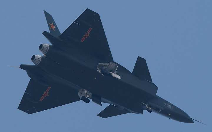 A Chengdu J-20 prototype during a test flight in January. Note the prominent canards, main landing gear stowage, and unstealthy nozzles. Via Chinese Internet