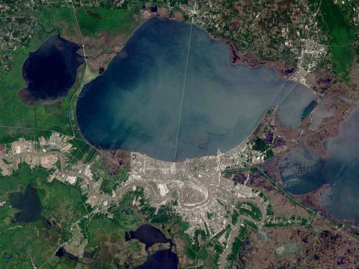 This satellite image shows the Greater New Orleans area, which totals more than 180 square land miles. The U.S. Army Corps of Engineers Hurricane and Storm Damage Risk Reduction System (HSDRRS), which traverses much of the area shown, will be completed by 2011. The HSDRRS will be a component of a larger effort to safeguard the entire Louisiana Coast. Image by Robert Simmon, based on data provided by the USGS/NASA Landsat 7 Science Team