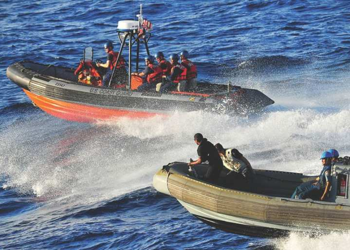 U.S. Coast Guardsmen from the Coast Guard Cutter Mellon, sailors from USS Vandegrift (FFG 48), and Indonesian sailors conduct combined operations aboard rigid-hull inflatable boats in the Java Sea, May 30, 2010. They were participating in Naval Engagement Activity (NEA) Indonesia 2010. In its 16th year, NEA is part of the Cooperation Afloat Readiness And Training (CARAT) series of bilateral exercises held annually in Southeast Asia to strengthen relationships and enhance force readiness.  DoD photo by Mass Communication Specialist 2nd Class David A. Brandenburg, U.S. Navy
