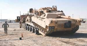 unloading Abrams tank