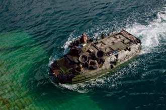 An AAV7 returns to the well deck