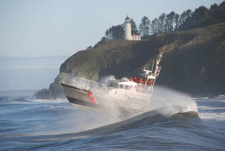 Instructors, crew, and students of a National Motor Lifeboat School class train for heavy weather boat operations in the harsh environment of Cape Disappointment in the Pacific Northwest, Nov. 12, 2009. U.S. Coast Guard photo by Petty Officer 1st Class Jamie E. Parsons