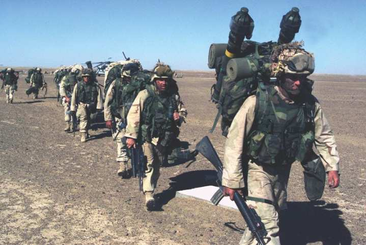 A Marine with the 15th Marine Expeditionary Unit (Special Operations Capable), Camp Pendleton, Calif., leads a column of Marines to a security position after seizing a Taliban forward operating base Nov. 25, 2001. Marines from the 15th and 26th MEU were deployed to the region in support of Operation Enduring Freedom. U.S. Marine photo by Sgt. Joseph R Chenelly