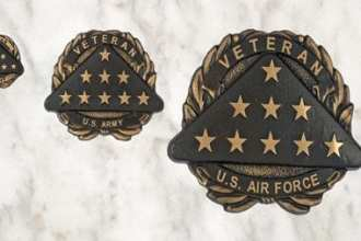 An added bonus for veteran contractors who work on these projects is that all the VA's Recovery Act dollars will, in some way, benefit other veterans by improving the facilities in which they receive medical care, infrastructure and systems, and the national cemeteries. The VA memorial medallion (above) is a new benefit available, however, to veterans buried in private cemeteries in lieu of a traditional government headstone or marker. DVA photo