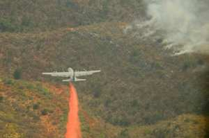 C-130 drops fire retardant