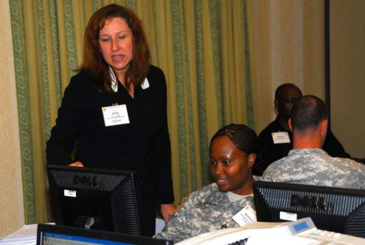 Kim Goffar, with the Office of Personnel Management, assists Staff Sgt. Natasha Dickenson in developing a resume on the federal jobs website, usajobs.gov, in the resume lab at the Heal, Help, Hire conference in Myrtle Beach, S.C. The DVA association with a veteran begins when he or she is still on active duty. Army photo by C. Todd Lopez