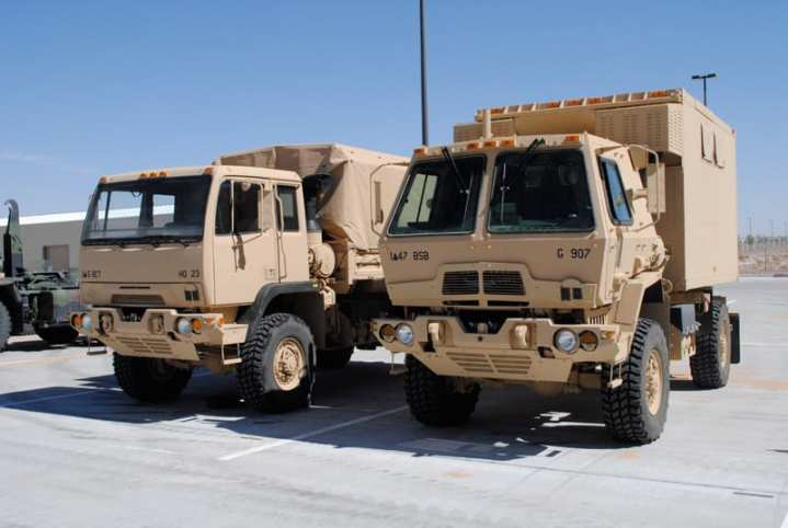 Two FMTVs with non-armored and armored cabs