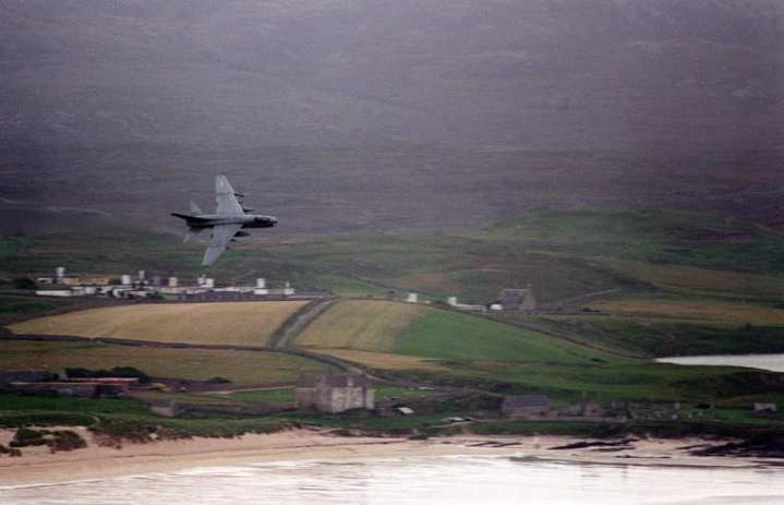 An A-7E Corsair II flies a low-level exercise