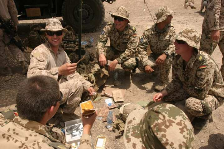 German Soldiers and U.S. Marines Exchange Rations