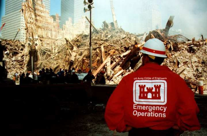 A member of the Army Corps of Engineers, emergency operations unit, surveys debris created by the collapse of the World Trade Center. U.S. Army Corps of Engineers photo