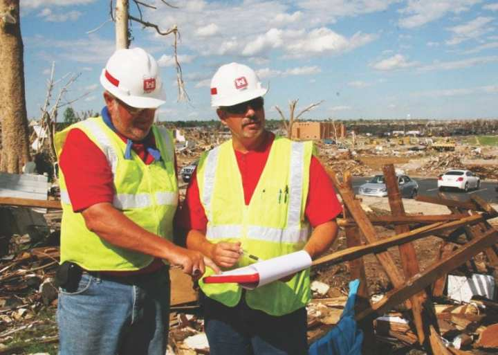 U.S. Army Corps of Engineers quality assurance inspector Steve Hart (left) discusses debris removal from a Joplin, Mo., home June 21, 2011, with USACE quality assurance supervisor Glen Locke. USACE was managing debris removal as part of the federal recovery effort of the May 22, 2011, tornado. U.S. Army photo by John Daves
