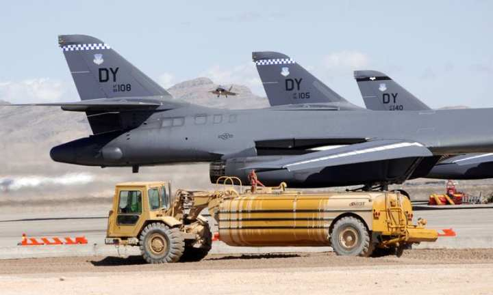 B-1 Lancers and an incoming F-22 Raptor are only some of the beneficiaries of runway improvements at Nellis Air Force Base, Nev. U.S. Army Corps of Engineers photo by Lee Roberts