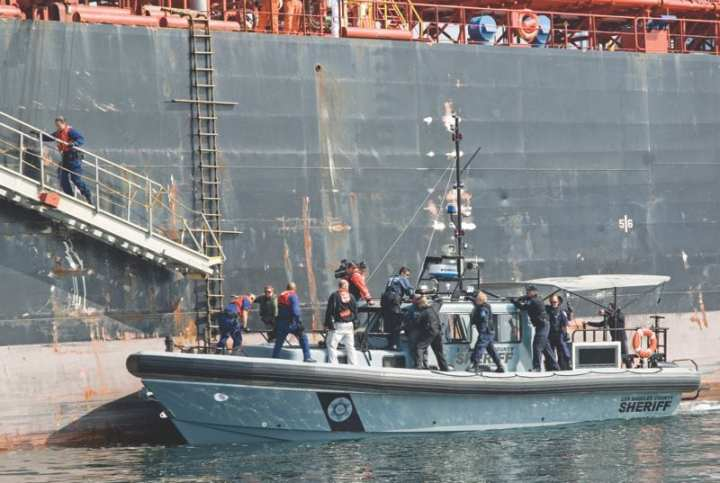Conducting joint federal, state, and local port partner boardings optimizes each partner's capabilities and is one best practice for information sharing. Here, the U.S. Coast Guard, Immigration and Customs Enforcement, California Border Patrol, Los Angeles County Sheriff's Department, and Los Angeles and Long Beach Port Police conduct a security boarding on a tanker vessel off the coast of Long Beach, Calif. U.S. Coast Guard photo by Petty Officer 3rd Class Cory J. Mendenhall