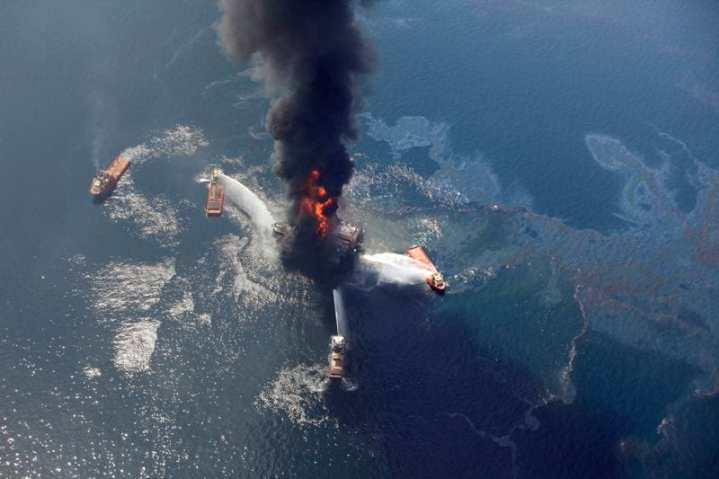 An April 21, 2010, aerial photo shows oil in the Gulf of Mexico, more than 50 miles southeast of Venice, La., as the Deepwater Horizon oil rig burns. The oil platform, which burned for more than a day after a massive explosion, sank into the Gulf on April 22, 2010. The resulting environmental emergency far surpassed the spillage of the 1989 Exxon Valdez oil spill in Alaska. An estimated 60,000 barrels of oil gushed each day for 87 days, making the Deepwater Horizon spill and its response unprecedented. As a result, the Coast Guard's role expanded under the National Contingency Plan and called for the service to direct all response efforts to contain and clean up the oil spill. AP photo/Gerald Herbert