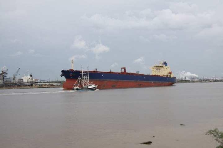 A fishing vessel comes close aboard a tanker in the narrow Sabine-Neches Channel. U.S. Coast Guard photo