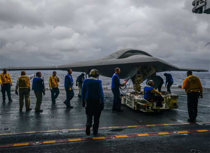 An X-47B Unmanned Combat Air System (UCAS) demonstrator aircraft is transported  on an aircraft elevator aboard the aircraft carrier Harry S Truman (CVN 75). U.S. Navy photo courtesy of Northrop Grumman by Alan Radecki