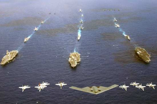 A B-2 Spirit and 16 other aircraft from the U.S. Air Force, Navy and Marine Corps fly over the USS Kitty Hawk, USS Ronald Reagan and USS Abraham Lincoln carrier strike groups in the western Pacific Ocean on Sunday, June 18, 2006 to kick off Exercise Valiant Shield 2006. The concept of a joint approach to combating emerging threats is nothing new. U.S. Navy photo BY Chief Photographer's Mate Todd P. Cichonowicz