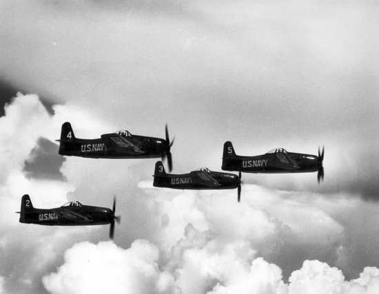 A flight of four F8F Bearcats flown by the Blue Angels flight demonstration team. U.S. Navy photo
