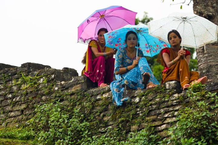 """Nepali women sit on a stone wall in Dhikur Pokhari village, Kaski district, Nepal, Sept. 11, 2012. Pacific Angel is a joint and combined humanitarian assistance operation conducted in the Pacific area of responsibility to support U.S. Pacific Command's capacity-building efforts. With """"individual empowerment,"""" will come the rise of a larger global middle class with greater access to education, technology, and health care. U.S. Air Force photo by Master Sgt. Jeffrey Allen"""