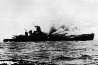 The Italian battleship Roma listing after being hit by German Fritz X radio-controlled bombs launched by Do 217s, Sept. 9, 1943. Italian Navy photo