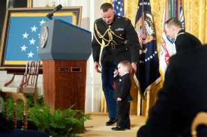 Colin Romesha, son of former Army Staff Sgt. Clinton L. Romesha, stands briefly at the podium during the Medal of Honor ceremony for his father at the White House in Washington, D.C., Feb. 11, 2013. Romesha received the Medal of Honor for his actions during a daylong firefight in Afghanistan in October 2009. U.S. Army photo by Staff Sgt. Teddy Wade