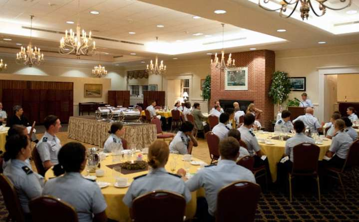 """Coast Guard Master Chief Petty Officer Lisa Starliper speaks to cadets at the U.S. Coast Guard Academy Sept. 24, 2012, during a special dinner commemorating the one year anniversary of the repeal of the """"Don't Ask, Don't Tell"""" policy. Since the repeal of DADT, the academy has stood up the Spectrum Council, one of six diversity councils under the USCGA Office of Inclusion and Diversity. This cadet-led group promotes the acceptance of LGBQ cadets and education of the corps regarding sexual orientation issues. It was the first group of its kind at a federal service academy. U.S. Coast Guard photo by Petty Officer 3rd Class Cory J. Mendenhall"""