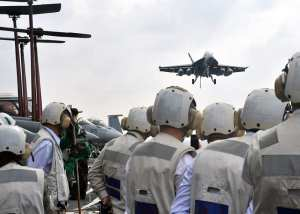 Distinguished visitors from Vietnam observe flight operations during a tour of the U.S. Navy's forward-deployed aircraft carrier USS George Washington (CVN 73), Oct. 20, 2012. Hosting these visitors was an attempt to show that the U.S. is committed to the region. U.S. Navy photo by Mass Communication Specialist Seaman Tatiana Avery