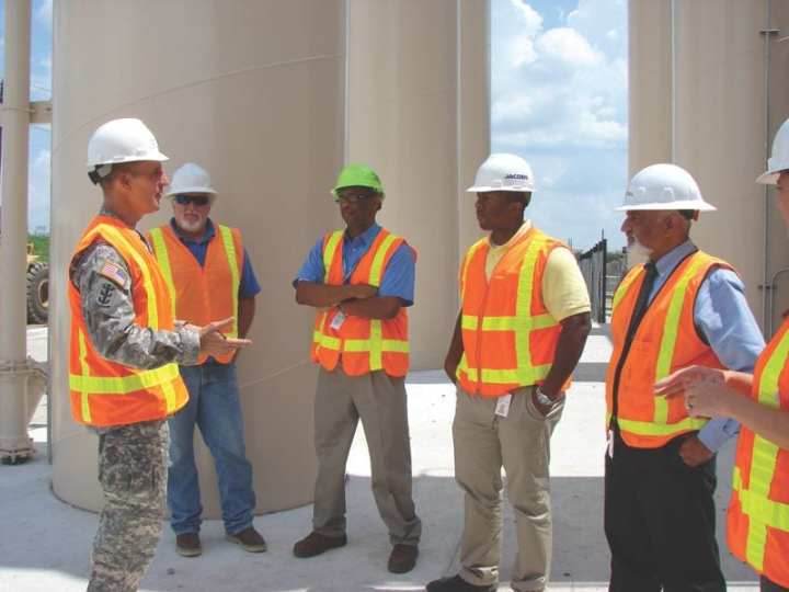 Brig. Gen. Thomas W. Kula, USACE Southwestern Division commander, takes time during a Fort Worth District site visit to the Pavaho Pump Station Aug. 28, 2012, to recognize Dallas workers for their hard work and dedication to the project, which lowers flood risk for the citizens of Dallas. Recognized, from left, were Mark Reed, a city construction superintendent at Pavaho; Sirak Bahta and Vincent Lewis, city engineers at Pavaho; and Dhruv Pandya, assistant director of operations, Trinity Watershed Management, for the city of Dallas. Sarah Standifer, partially obscured, assistant director, Trinity River Corridor Project and Stormwater Management for the city, was also recognized. U.S. Army Corps of Engineers photo by James Frisinger