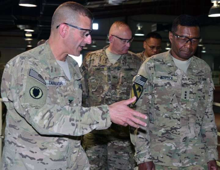 Col. Robert M. Taradash, commander, Task Force Protector (left), Col. Robert A. Sinkler, commander, U.S. Army Corps of Engineers (USACE) Rock Island District (middle), and Lt. Gen. Thomas P. Bostick, USACE commanding general and chief engineer, tour the detainee housing unit at the Detention Facility in Parwan (DFIP), in the Parwan province of Afghanistan, on June 6, 2012, to determine current and future infrastructure requirements. Bostick serves as the senior military officer overseeing most civil works infrastructure and military construction in the United States, but USACE also has a key role in support of overseas contingency operations, including those in Afghanistan. Photo by Faiza Evans