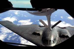 A B-2 Spirit stealth bomber is refueled in-flight by a KC-135 on Jan. 23, 2013, over the Pacific Ocean. Two B-2 crews from the 509th Bomb Wing, Whiteman Air Force, Mo., flew training missions out of Andersen Air Force Base, Guam in support of in-theater training objectives. The B-2s that flew to South Korea conducted a non-stop 6,500 mile flight that would have required several air-to-air refuelings. U.S. Air Force photos by Airman 1st Class Brooke P. Doyle