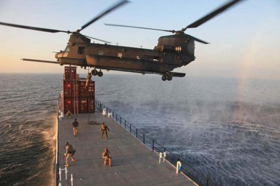 CH-47 marines rappel onto cargo ship