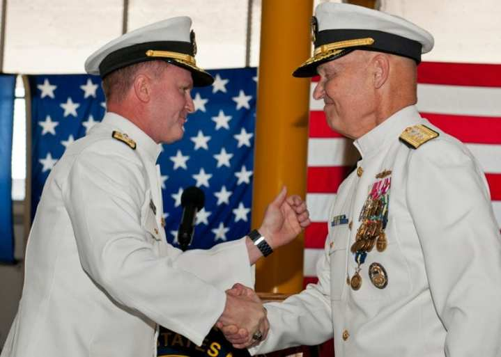 Rear Adm. T.K. Shannon (left) and Rear Adm. Mark Buzby congratulate each other during a change-of-command ceremony aboard the USNS Spearhead (JSHV 1) May 10, 2013. Shannon relieved Buzby as commander, Military Sealift Command. U.S. Navy Photo by Mass Communication Specialist Seaman Apprentice Jesse A. Hyatt