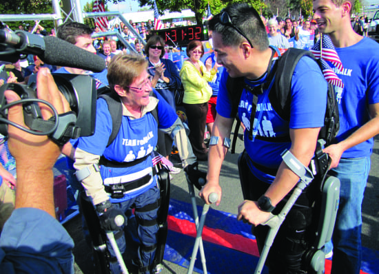 Sgt. Theresa Hannigan at the finish line of the Hope for Warriors walk/run fundraiser in New York. She walked a mile using theReWalk™ exoskeleton, a motorized orthotic device. Courtesy of Argo Medica l TEc hnologies