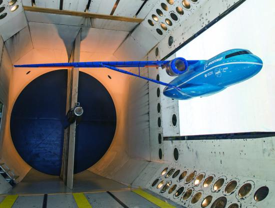 "Engineers at NASA's Langley Research Center in Hampton, Virginia, installed this 15 percent scale model based on a possible future aircraft design by The Boeing Company in its Transonic Dynamics Tunnel. The 13-foot model is ""semi-span,"" meaning it looks like a plane cut in half. It is being used to assess the aeroelastic qualities of the unusual truss-braced wing configuration. (The ""truss"" is the diagonal piece attached to the belly of the fuselage and the underside of the wing.) Boeing designed the concept as part of the SUGAR (Subsonic Ultra-Green Aircraft Research) program to help conceive of airplane technologies and designs needed 20 years from now to meet projected fuel efficiency and other ""green"" aviation requirements. NASA Langley/Sandie Gibbs"