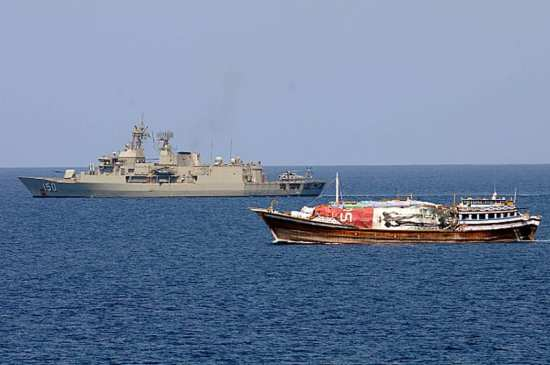 The Royal Australian Navy frigate HMAS Anzac (FFH 150) is underway alongside a dhow in the Gulf of Aden, Oct. 4, 2012. U.S. Navy photo by Mass Communication Specialist 2nd Class Aaron Chase