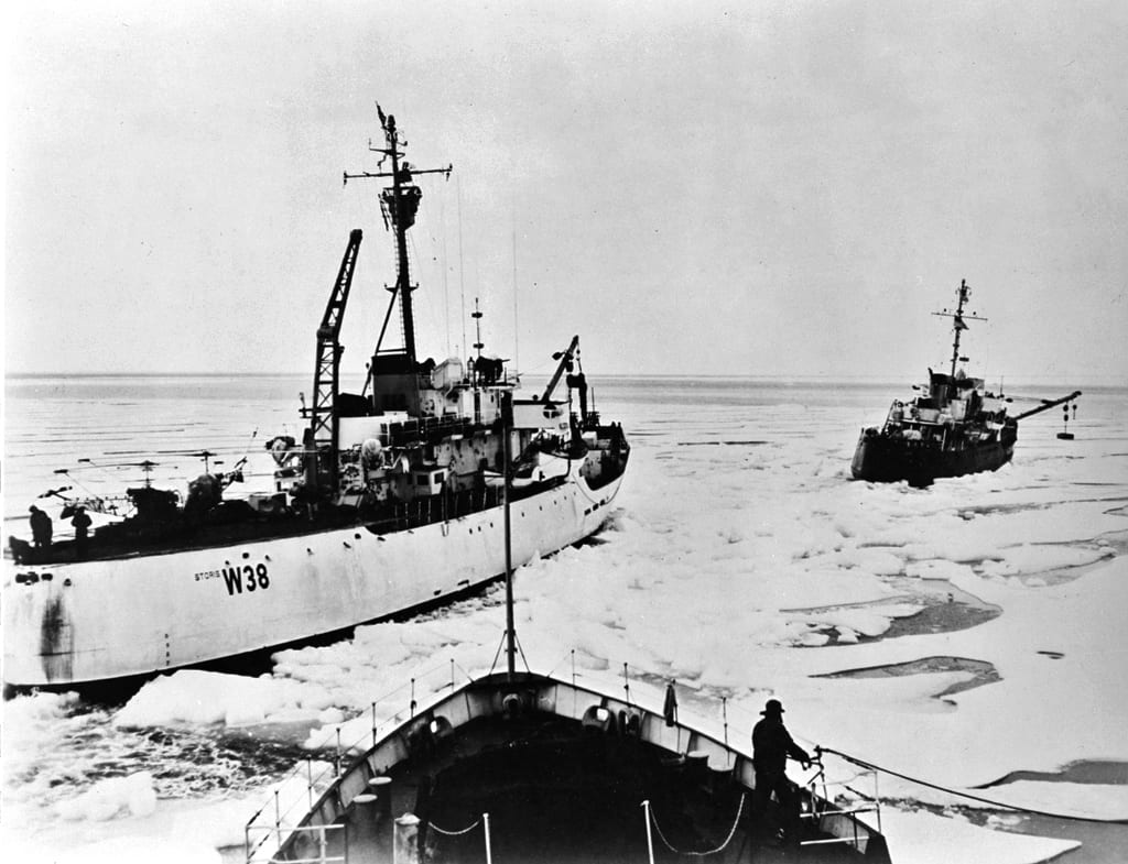 The CGCs Spar, Storis, and Bramble make their way through Arctic ice during the first transit of the Northwest Passage by a U.S. vessel, circa 1957. The lead cutter has a weight suspended over its starboard side. By swinging this weight back and forth across the centerline, the vessel could rock to free itself from ice. Library of Congress photo