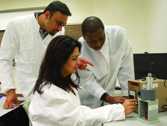 Dr. Sukesh Aghara, left, gives graduate students Khoie Pavastoo and Ruben Gener instruction on instrument calibration at a Center for Radiation Engineering and Science for Space Exploration (CRESSE) lab at Prairie View A&M University in Texas. Aghara heads radiation transport simulation activities for the NASA center. NASA image