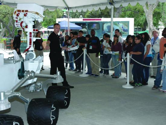 Students at the 2010 Summer of Innovation see a full-scale model of the rover Curiosity. NASA/JPL-Caltech